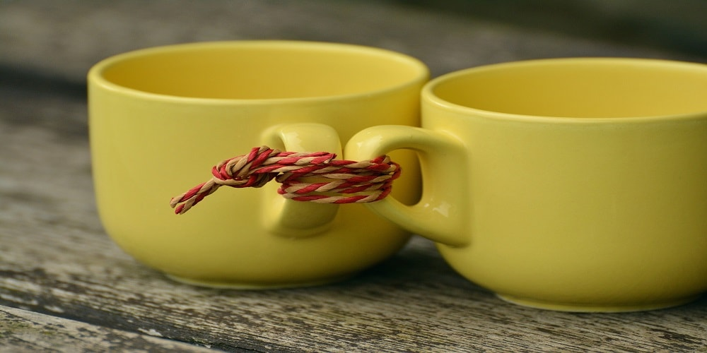 Two cups connected with string